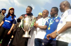 PIC. 16. FROM LEFT: WIFE OF THE GOVERNOR OF AKWA IBOM, MRS MARTHA EMMANUEL; GOV. UDOM EMMANUEL; THE CHAIRMAN OF AKWA UNITED FC, MR NSE UBE; CAPTAIN OF THE TEAM, MR OTO OFFIONG, AND COMMISSIONER FOR YOUTH AND SPORTS, MR MONDAY UKO, CELEBRATE WITH THE 2015 FEDERATION CUP PRESENTED TO THE GOVERNOR BY MR UBE IN UYO ON WEDNESDAY (25/11/15). AKWA UNITED FC WON THE TROPHY AFTER DEFEATING LOBI STARS OF MAKURDI 2-1.