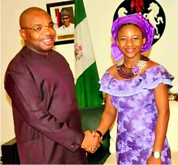 Governor Udom Emmanuel in a handshake with Christiana Esio Udoh