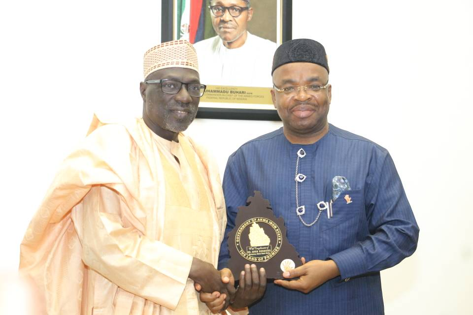 Mr Udom Emmanuel (middle), former Peoples Democratic Party, PDP, Chairman Alhaji Ahmed Markarafi